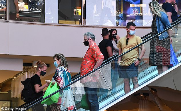 Customers wear face masks at Westfield Bondi Junction after they became mandatory in Sydney