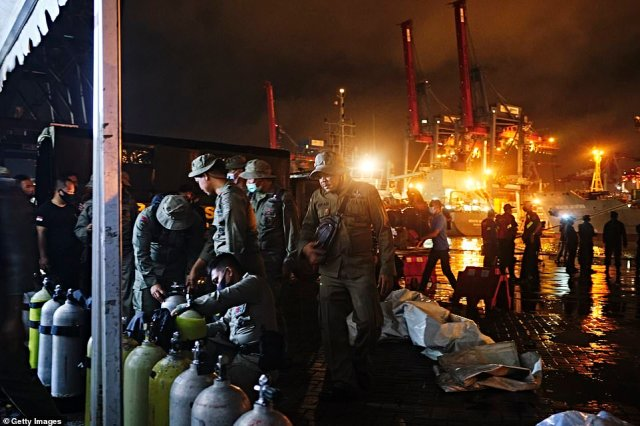 Indonesian Police divers check their gear before embarking on the search and rescue operation for Sriwijaya Air flight SJ 182