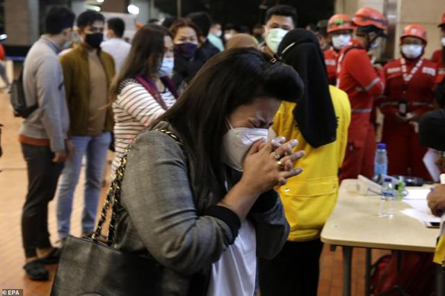 A terrified loved one of one of the missingSriwijaya Air passengers prays as they await news. The aircraft went missing earlier today