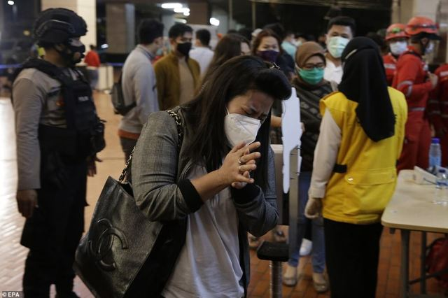 Relatives of Sriwijaya Air plane passengers arrive at the crisis center in Soekarno-Hatta International Airport to wait for news of their loved ones