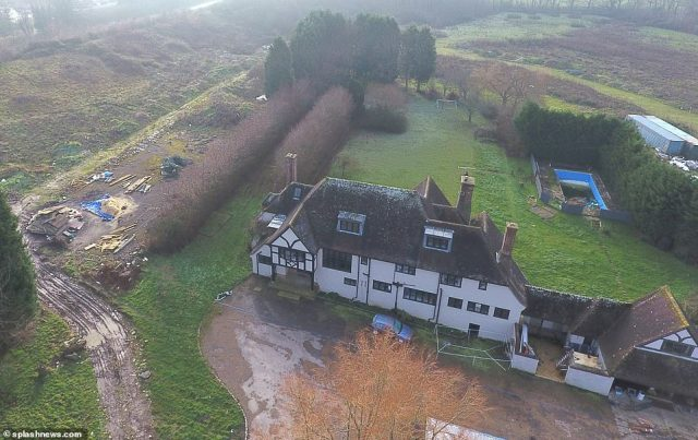 Claims: But as her old property continues to fall into disrepair with reports its suffering from sewage water build-up (Katie's so-called 'mucky mansion' pictured), it seems Katie's new house isn't any happier as it's reported the house is becoming overrun with rats due to the never-ending piles of mess