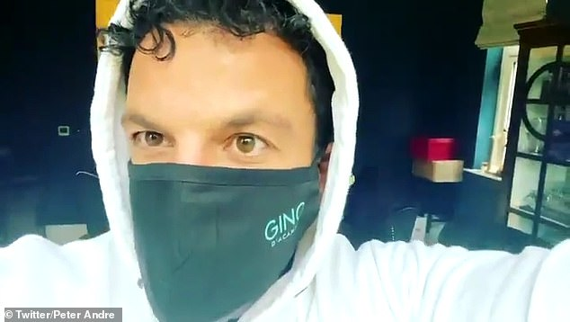Peter Andre sports a Gino D'Acampo face mask indoors after testing positive for COVID-19