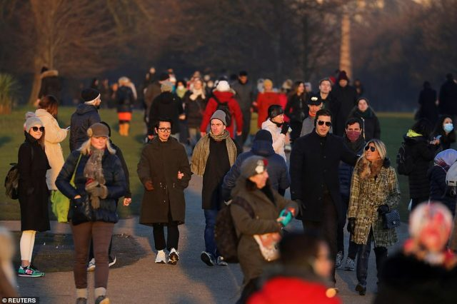 People walk at Kensington Palace Gardens, amid the spread of the coronavirus disease in London, January 9, where mayor Sadiq Khan has  has declared a Covid-19 emergency hospitals struggle to cope with number of patients
