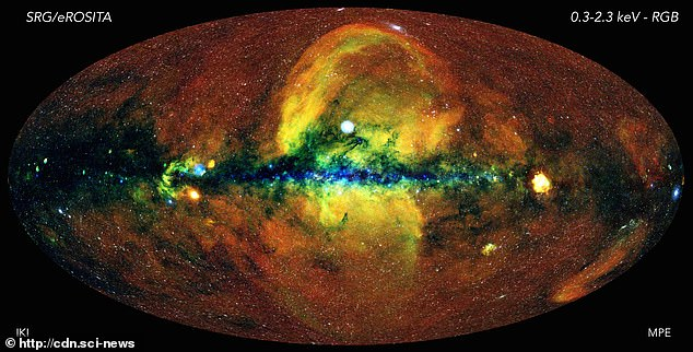 The yellow clouds seen billowing from the centre of the Milky Way galaxy has had experts scratching their heads for decades