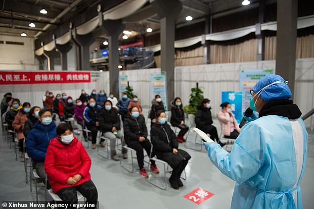 Beijing claims that a `` cluster of pneumonia cases of unknown cause '' first appeared on December 31, 2019 in Wuhan.  Pictured: A staff member talks about precautions before receiving the Covid-19 vaccine in Chaoyang district, Beijing