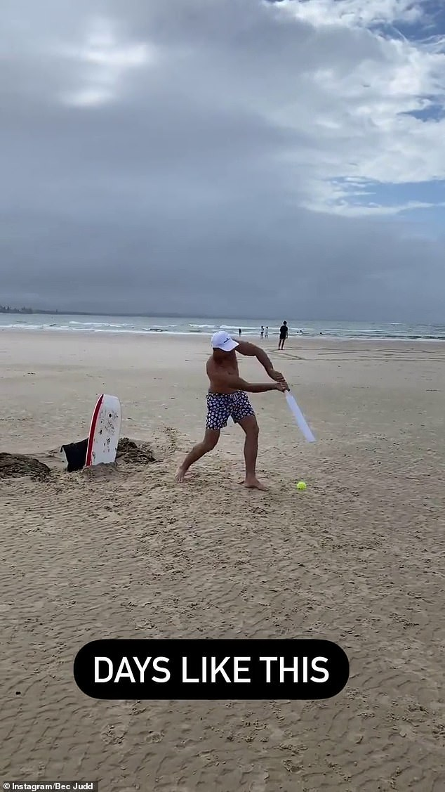 'Days like this': In a separate video uploaded to her Instagram Stories, Bec filmed her AFL star husband, Chris Judd, playing beach cricket with their children