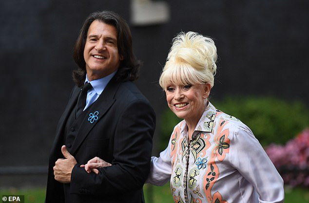 Love: The EastEnders legend was laid to rest at Golders Green crematorium on Friday after losing her battle with Alzheimer's in December, aged 83 (pictured with Scott in 2019)
