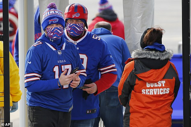 Fans arrive at Bills Stadium for an NFL wild-card playoff football game against the Colts