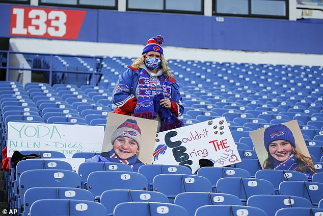 A Buffalo Bills fan watches as her team warms up before an NFL wild-card playoff game
