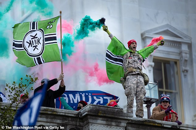 The flag, pictured above on Wednesday,  was originally created by some members of the 4chan online community to represent a joke country Kekistan. The nation is ruled by the frog-headed deity Kek, who is often represented by Pepe the Frog