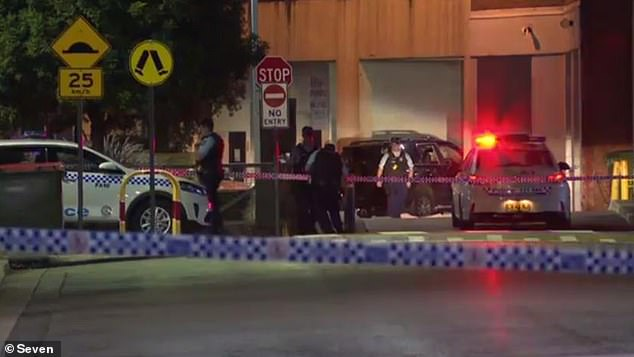 Police are pictured at the scene after the deadly shooting. Kettule is believed to be a member of the True Kings street gang