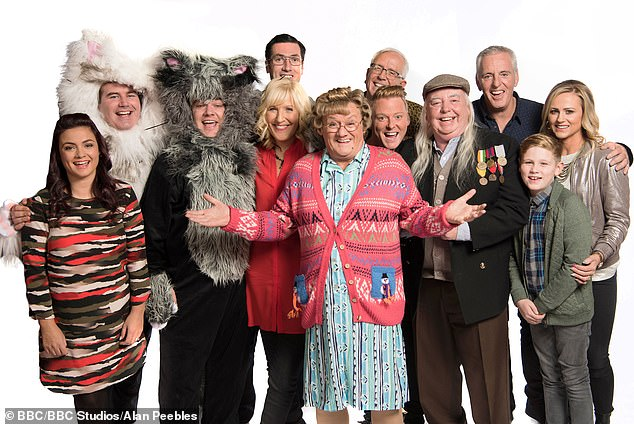 Mammy's clan: Cast members of Mrs Brown's Boys and their relationship to Brendan O'Carroll – left to right – Fiona O'Carroll (daughter), Paddy Houlihan (no relation), Danny O'Carroll (son), Martin Delany (son-in-law), Jennifer O'Carroll (wife) Brendan O'Carroll, Rory Cowan (no relation), Gary Hollywood (circled, no relation), Dermot O'Neill (no relation), Pat Shields (no relation), Jamie O'Carroll (grandson), Amanda Woods (daughter-in-law)