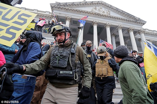 Members of the Oath Keepers are seen among supporters of President Donald Trump at the U.S. Capitol during a protest against the certification of the 2020 presidential election results