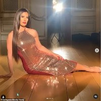 Rebekah Vardy dazzles in a metallic gold gown as she poses for glamorous photoshoot