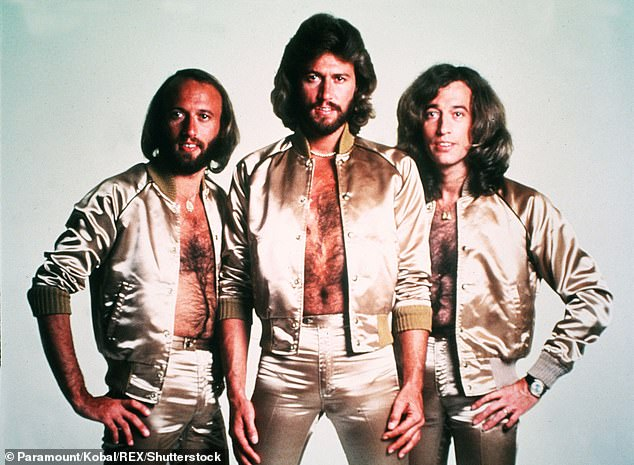 Flashback: Lisa then asked if the skintight outfits had any effect on the group's singing. 'Did that give the falsettos extra oomph?' she asked. 'Are you suggesting that the tight pants were responsible for the falsetto? I take issue with that!' Barry joked. The Bees are pictured in 1977
