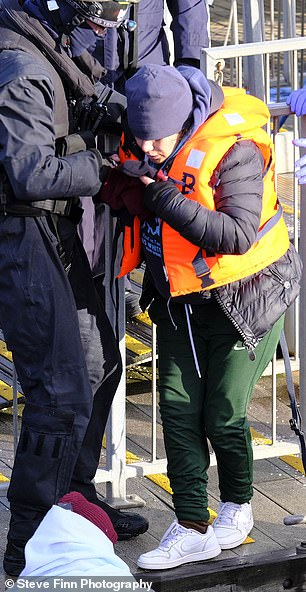A person is brought ashore by Border Force officials