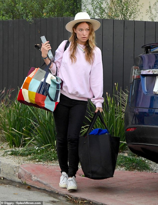 Hands full: Olivia Wilde carried a slew of belongings out of the Los Angeles-area home she shared with ex-fiance Jason Sudeikis on Saturday morning