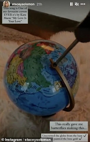 Preparing: She unscrewed the globe from its stand before spraying it gold