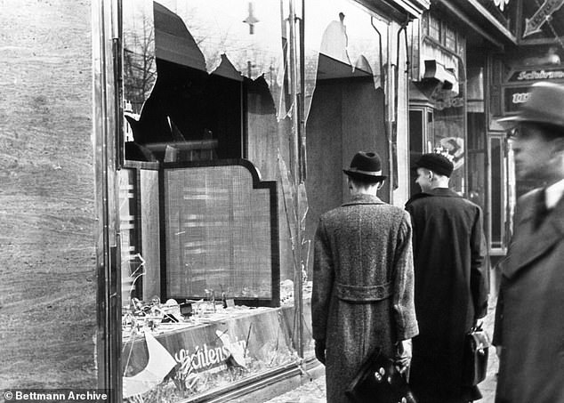 Infamy: Kristallnacht, on November 9, saw Jewish business' windows shattered, giving it its name - but that was only the start of far worse Nazi violence. An orgy of destruction left at least 91 dead, 30,000 Jewish men arrested and Hitler's intent graphically demonstrated to the world