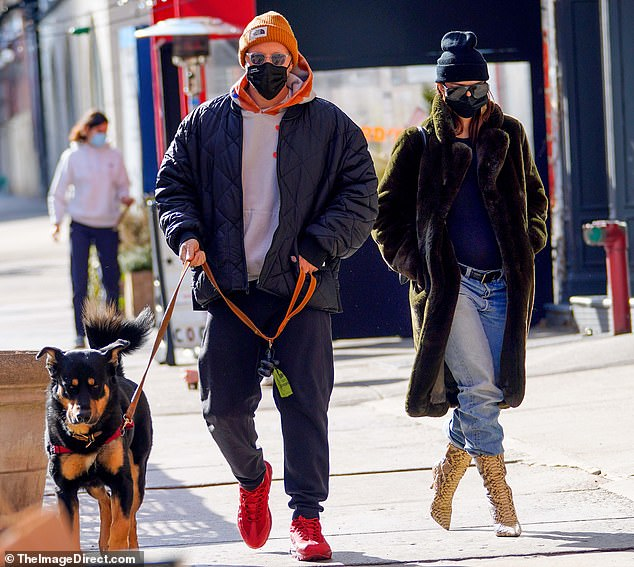Maternity style: Pregnant Emily Ratajkowski, 29, shows off her maternity street style on a walk in NYC with husband Sebastian Bear-McClard and their dog Colombo after making the jump from Los Angeles