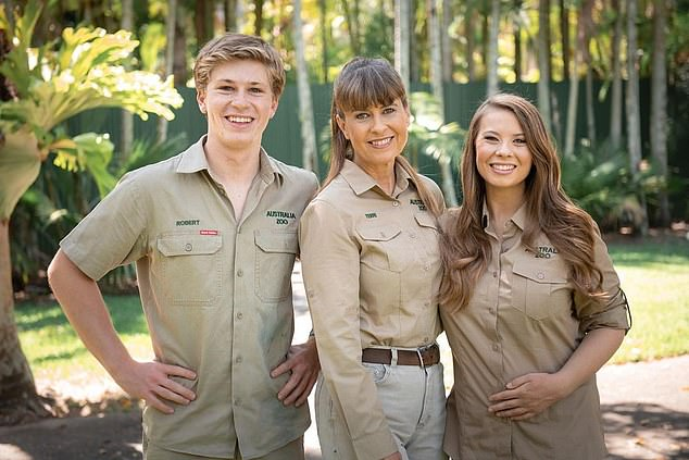 Fears for Australia Zoo: Sources claim the Irwins aren't 'out of the woods yet' as closed borders mean NO international visitors for the foreseeable future amid the family's financial hell. Pictured: Robert, Terri and Bindi Irwin