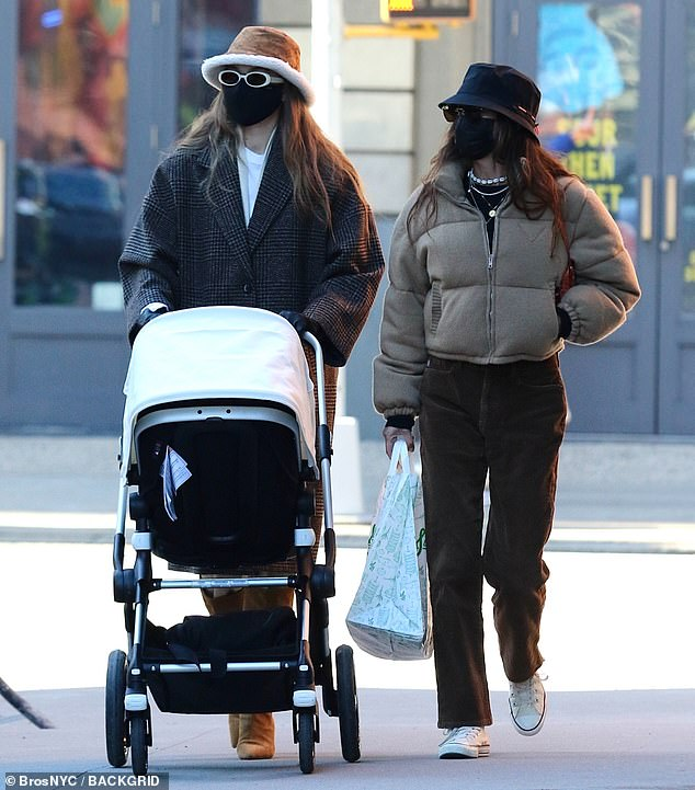 Stylish stroll: The model sported a large tweed jack while walking with her daughter and friend after lunch