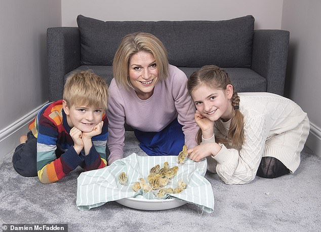 Antonia Hoyle with children, Felix and Rosie, at home in Belmesthorpe, Rutland, with the family's fourteen newly hatched chicks from Quail eggs brought from Marks and Spencer