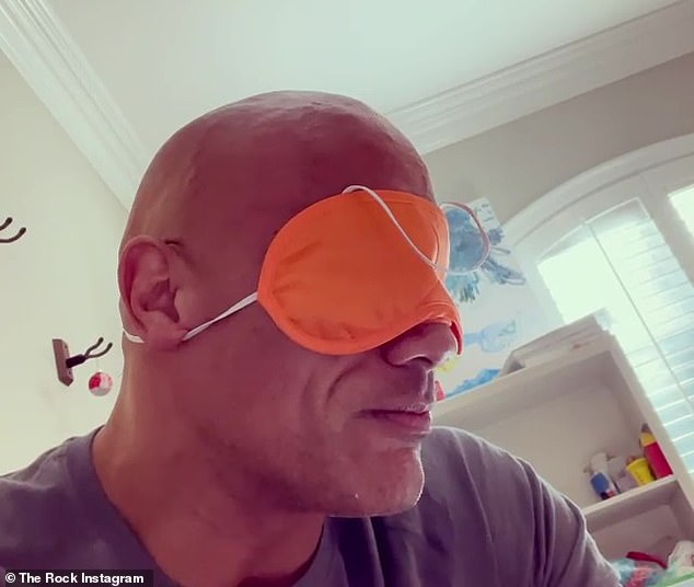 Playtime: On Sunday, Dwayne Johnson shared a video to his Instagram showing him having some fun with his daughter Tiana, who placed an orange sleeping mask over his eyes
