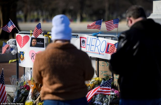 People pay their respects at a memorial for fallen police officer, Brian Sicknick in Washington, DC