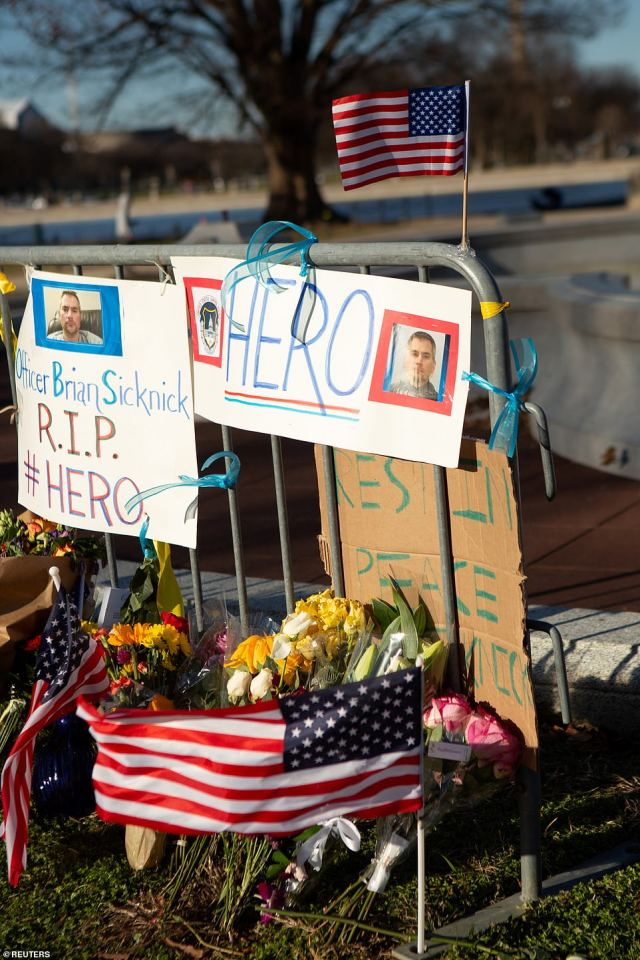A memorial to honor slain Capitol Police Officer Brian Sicknick sits on the west side of the U.S. Capitol building on Capitol Hill