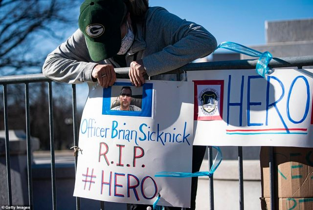 A makeshift memorial for Officer Sicknick has been set up close to the ground of the U.S. Capitol