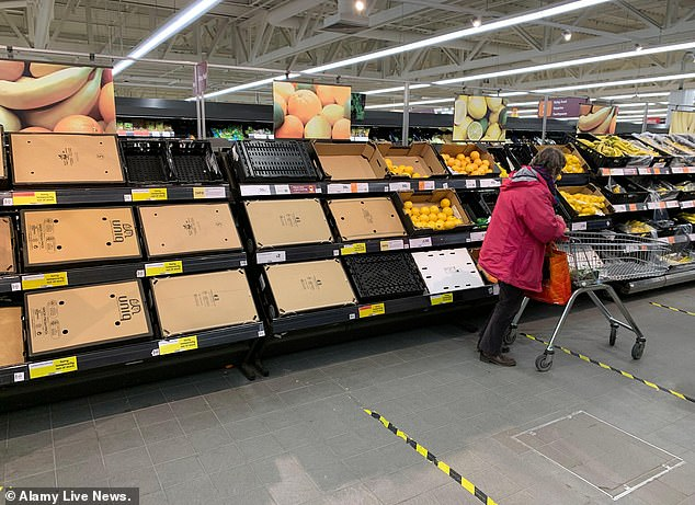 Lettuce, cauliflower packs, oranges, strawberries, raspberries and blueberries are listed as ¿out of stock¿ in some areas on Tesco¿s website. Pictured: Sainsbury's runs low on fruit and veg in Haverhill, Suffolk