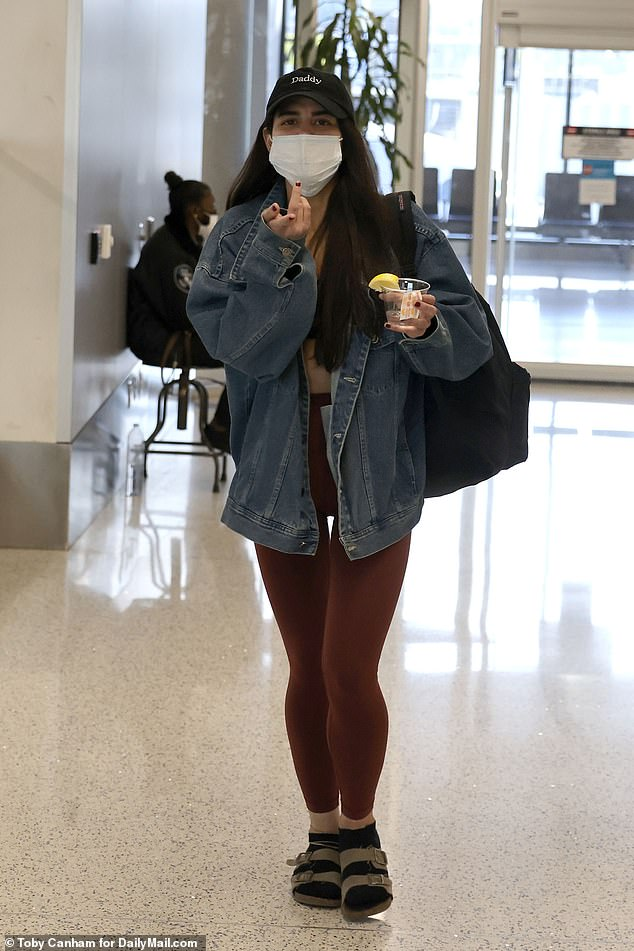 'Soho Karen' Miya Ponsetto, 22, touched down at Los Angeles International Airport with a drink in hand on Sunday afternoon after leaving New York, where she was arraigned on assault charges for attacking 14-year-old Keyon Harrold Jr, claiming he stole her phone