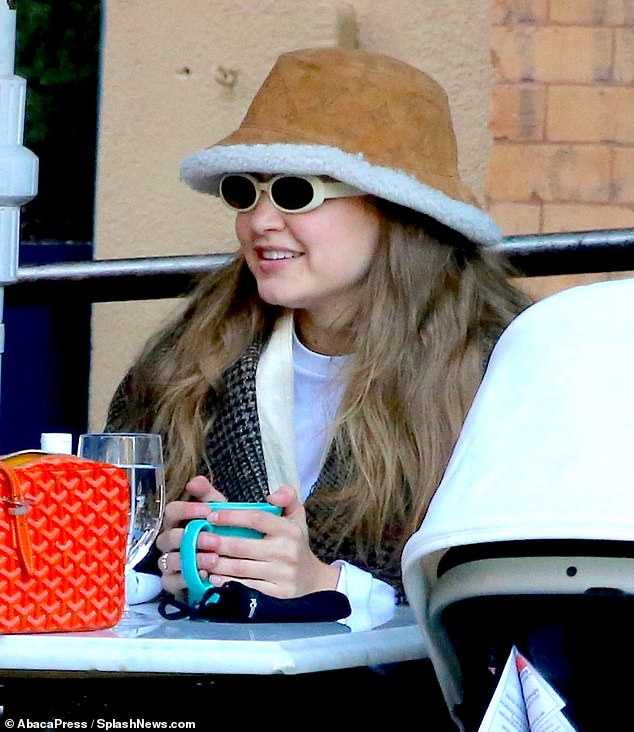 Model mom: Gigi Hadid, 25, was joined by her baby daughter Sunday as she enjoyed lunch with a friend in New York City