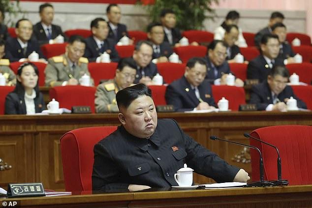 North Korean leader Kim Jong Un, center, attends the ruling party congress in Pyongyang, North Korean, Saturday