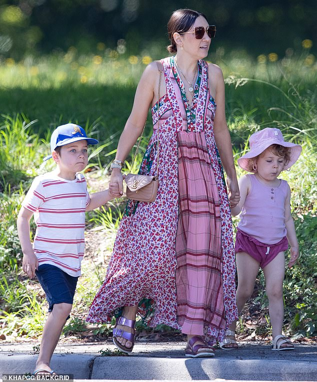 Weekend vibes: The Go-To skincare founder, 40, stepped out in a colourful maxi dress as she held hands with her children, son Sonny, six, and daughter Rudy, three