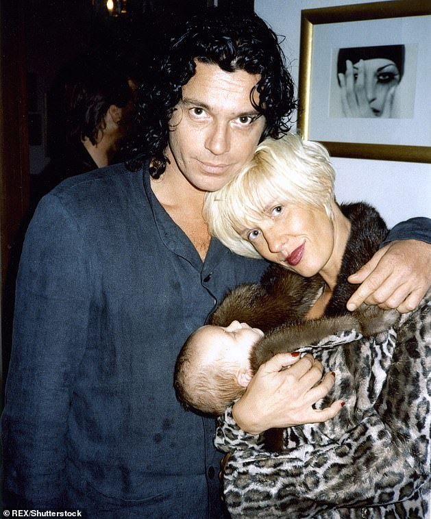Orphaned: Her mother, Paula Yates (left), was found dead at her home in London less than three years later. The family are pictured in1996