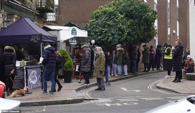 People queue up for crepes in freezing temperatures on Hampstead high street