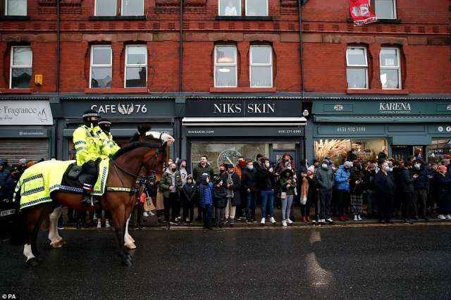 Mounted police control the crowds outside Rossett Park stadium on Merseyside for the Emirates FA Cup third round match