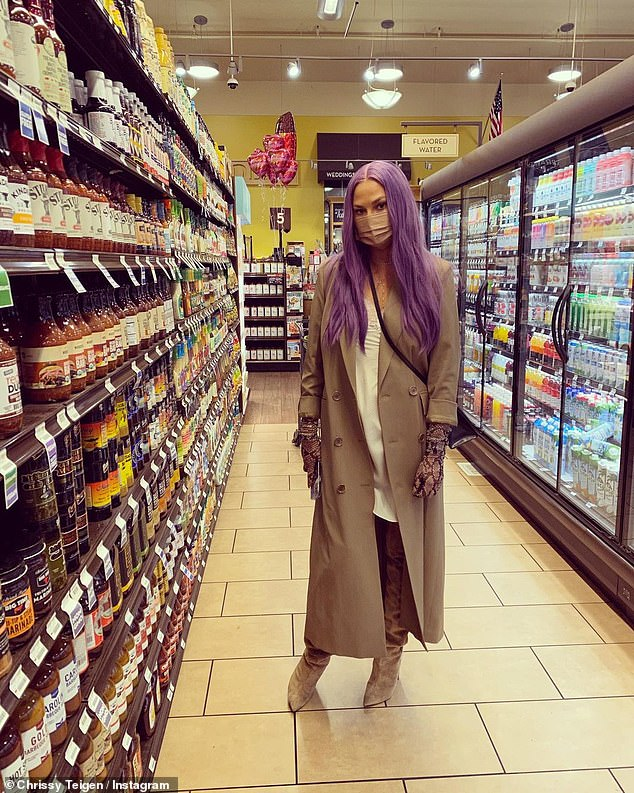Saucy: Teigen posed at a Southern California grocery story next to the condiment aisle