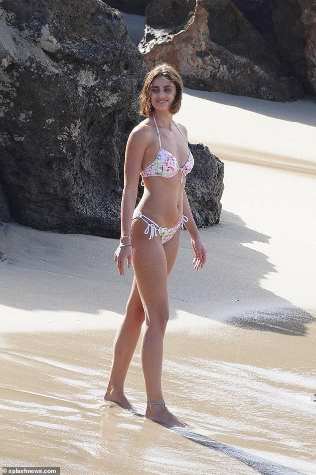 Hard at work! Victoria's Secret Angel Taylor Hill took part in a seaside bikini shoot for the San Francisco bra brand in Saint Barthélemy on Saturday