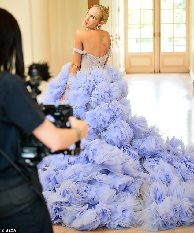 Long gown:She also was seen in a long, light blue off-the-shoulders ballgown