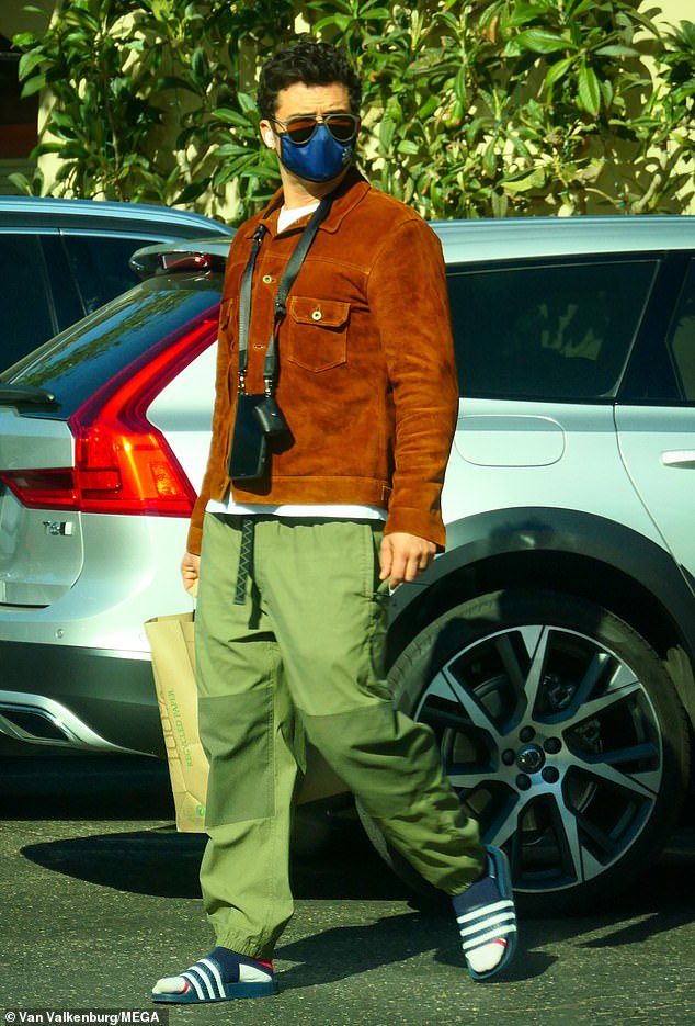Style:The Lord of the Rings actor, 43, looked stylish and laidback in a burnt orange suede jacket worn over a white t-shirt as he stepped into the sun