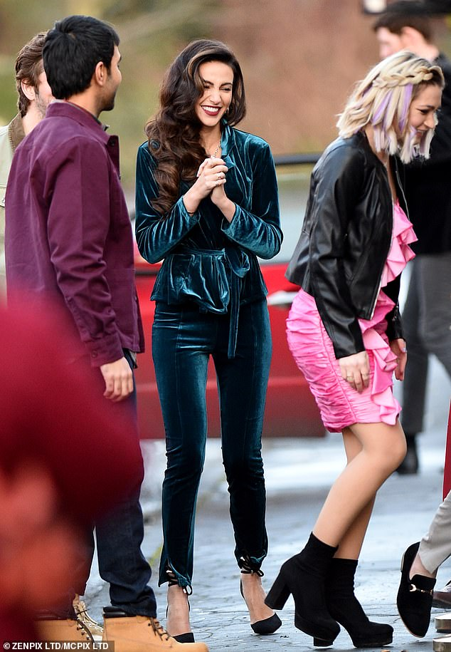 Filming: She made sure to stand out from the crowd in the glamorous ensemble as she was joined by characters including JJ (Parth Thakerar) and Tommo (Ryan Sampson)