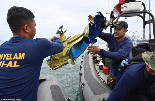Navy divers are seen retrieving wreckage from the aircraft.Police asked families to provide information to help identify any bodies retrieved such as dental records and DNA samples