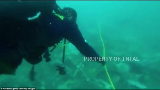 Underwater divers are searching for the plane's black boxes which will help explain why the jet plunged so quickly