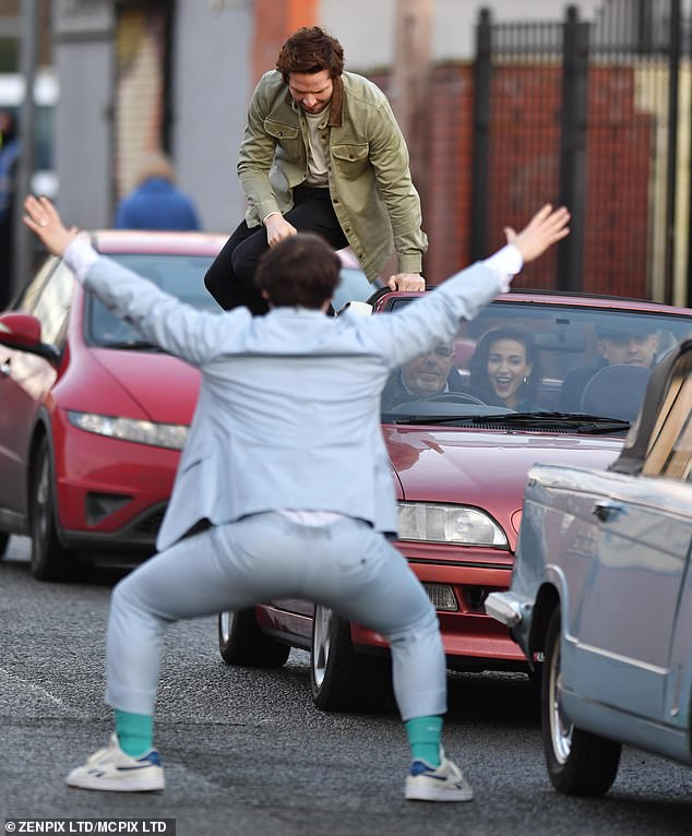 Fun times: Hilarious scenes saw the groom dancing in front of guests' cars as they arrived at his wedding reception, while another actor jumped out of a roofless red car