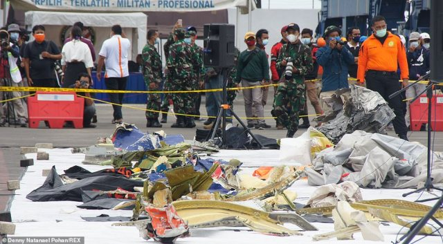 Shrapnel from the Sriwijaya Air plane was lifted from the crash site around the Thousand Islands as investigators say the jet was likely in tact when it smashed into the water