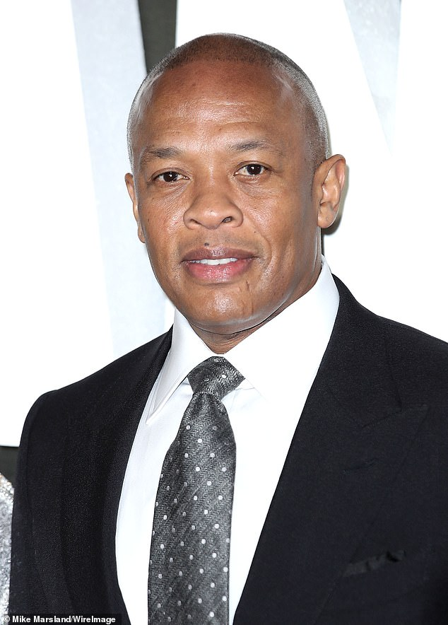 Taking care: Dr Dre remains in intensive care a week after his brain aneurysm, in case he suffers another one... as doctors battle to work out the cause (pictured in 2018)