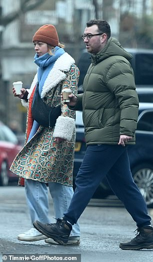 Stroll: Sam, who wore a pair of black rounded glasses, was fully engaged in conversation as they strolled near their pal as they headed towards Regents Park